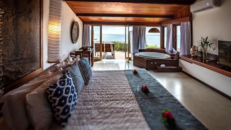 Quarto e cama no Hotel Sombra e Água Fresca em Pipa