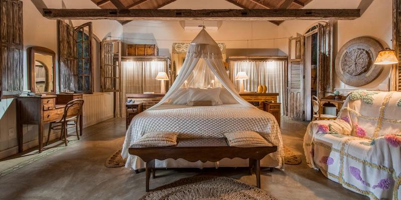 Quarto e cama na Pousada Toca da Coruja em Pipa